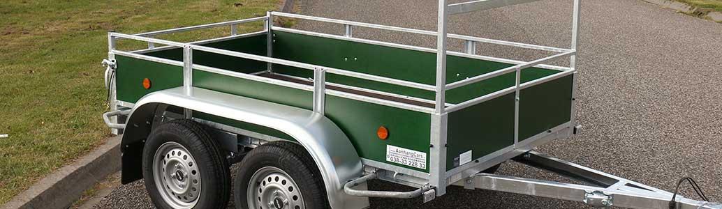 Tandemas open aanhangwagen groen betonplex